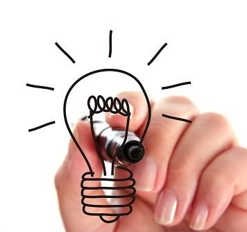 Female hand drawing a light bulb